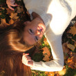 Woman girl portret in autumn leaf - Stock Photo