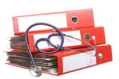 File folders with stethoscope isolated on white — Stock Photo