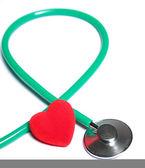 красные сердца и зеленый изолированных стетоскоп — Стоковое фото