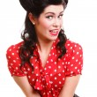 Woman pin-up make-up hairstyle posing in studio - Stock Photo