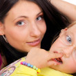 Happy mother and little girl having fun — Stock Photo