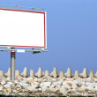 Blank white billboard breakwater and sky — Stock Photo #21219879