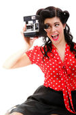 Excited retro girl with vintage camera — Stock Photo
