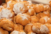 Profiteroles choux pastry buns with whipped cream — Stock Photo