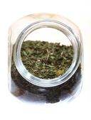 Close up jar with lovage spice isolated — Stock Photo