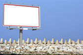 Blank white billboard breakwater and sky — Stock Photo