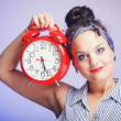Woman with red clock. Time management concept. — Photo