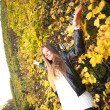 woman girl portret in autumn green leaf wall — Stock Photo