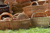 Brown baskets in green grass — Stock Photo