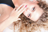 Beautiful long blond curly hair of young attractive woman — Stock Photo