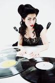 Sexy girl with phonography analogue record — Stock Photo