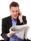 Man looks surprised while reading a newspaper — Stock Photo