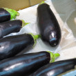 Black eggplants in market - Stock Photo