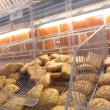 Fresh baked buns at a supermarket - Stock Photo