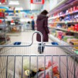 View of a shopping cart with grocery items — Stock Photo #22001185