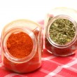 Royalty-Free Stock Photo: Jars with spices paprika and lovage isolated
