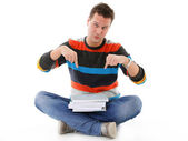 Male student offering books isolated — Stock Photo