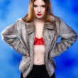 Stock Photo: Sexy woman in fur coat and red bra