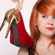 Fashion woman with red high heel shoes — Stock Photo