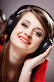 Close up smiling girl with headphones — Foto de Stock