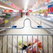 View of a shopping cart with grocery items — Stock Photo #22386395