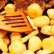 Seasoned potato slices in skillet pin kitchen — Stock Photo #22429597