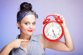 Woman with red clock. Time management concept. — Stock Photo