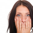 Young woman covering her mouth both hands isolated — Stock Photo