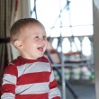 Closeup portrait of cheerful little boy smiling — Stock Photo #22484827