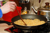 Skillet with rice — Stock Photo