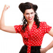 Cheerful pin up woman flexing biceps isolated — Stock Photo #22537505