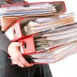 Female office worker carrying a stack of files — Stock Photo
