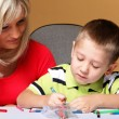 Stock Photo: Mother and son drawing together