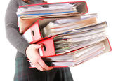 Female office worker carrying a stack of files — Stockfoto