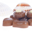 Chocolate pralines and shells — Stock Photo #22659055