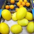 A lot of melon and oranges in market place — Stock Photo
