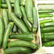 Green zucchini courgette  in the supermarket - Foto Stock