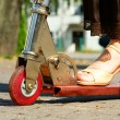 Woman foot ride a scooter — Stock Photo