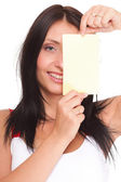 Gift card. Excited woman showing empty blank paper card sign — Stock Photo