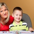 Mother and son drawing together - Stock Photo