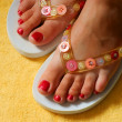 Female feet and flip-flop - Stock Photo