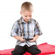 Child plays games on the mobile phone — Stock Photo
