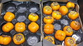 Orang persimmons, kaki fruits in box — Stock Photo