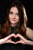 Girl doing heart shape love symbol with her hands. — Stock Photo