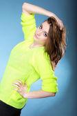 Attractive girl in bright vivid colour sweater — Stock Photo