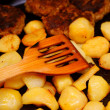 Seasoned potato slices in skillet pin kitchen — Stock Photo #23550141