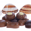 Chocolate pralines and shells — Stock Photo