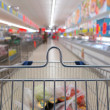 View of a shopping cart with grocery items — Stock Photo #23550237