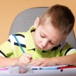 Young cute boy draws with color pencils — ストック写真