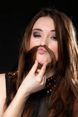 Grimacing. Girl hair moustaches making silly face — Stock Photo
